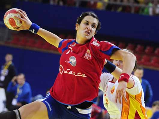 Serbia's Lekic scores against Macedonia during handball match in Skopje