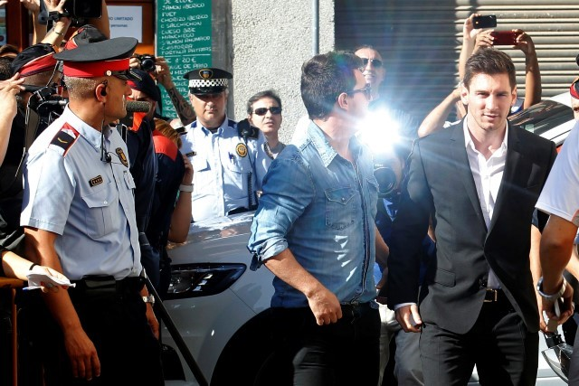 Barcelona forward Lionel Messi arrives in court to answer charges of tax evasion in Gava