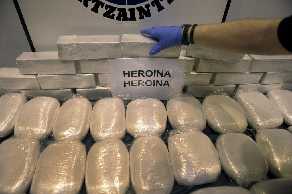 Officer of the General Criminal Investigation Unit of the Basque regional police Ertzaintza shows heroin seized following Operation Outage in Bilbao