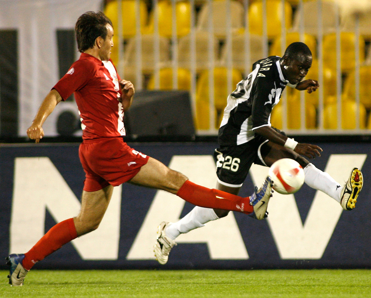 Partizan Belgrade player Lamina Diara from Senegal, right, in action against Sasa Dragicevic, left, from Zrinjski, Mostar, Bosnia and Herzegovina, during UEFA Cup, first qualifying round, second leg, soccer match in Belgrade, Serbia, Thursday, Aug. 2, 2007. (Srdjan Stevanovic/starsportphoto.com)