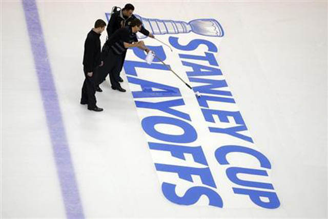 Crews prepare the ice for the start of the Stanley Cup Playoffs following the NHL hockey game between the Boston Bruins and the Ottawa Senators in Boston
