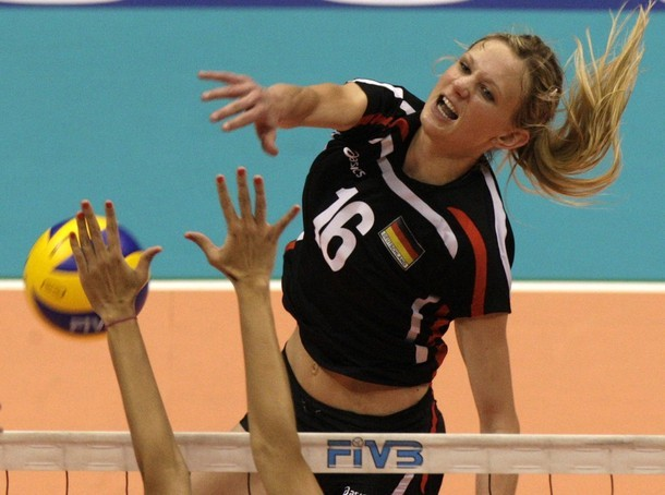Kozuch of Germany spikes the ball against Puerto Rico during their women's volleyball match at the FIVB World Grand Prix in Rio de Janeiro